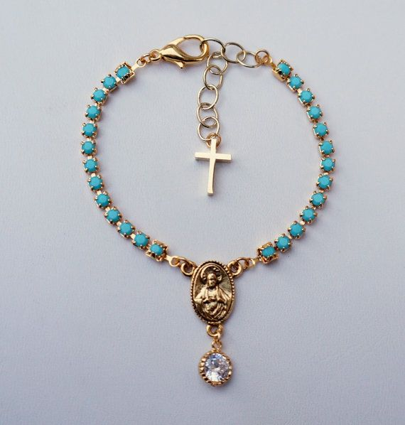 great colors for this coming Spring!    this gorgeous rosary inspired bracelet features:    -genuine Swarovski Crystal turquoise chain -a