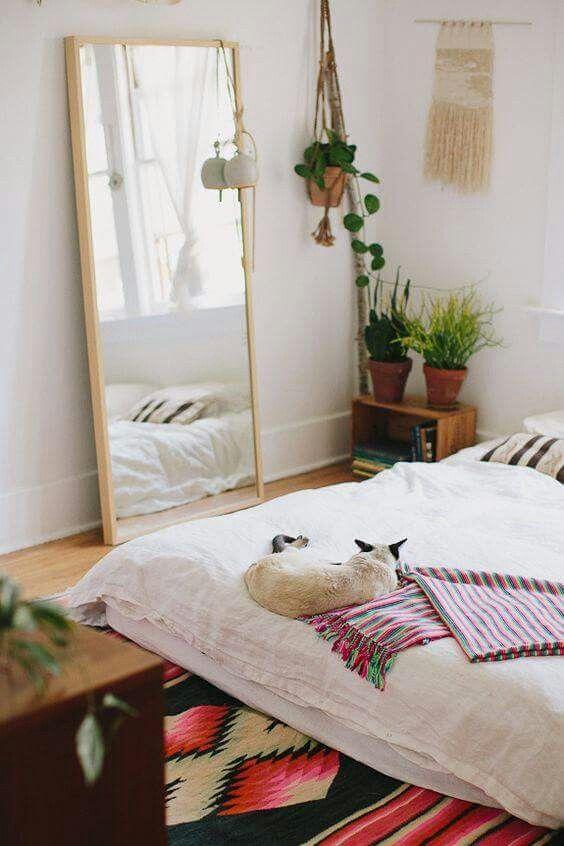 Floor mirror and plants, bed on floor