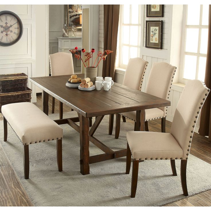 Invitingly cozy, this six-piece dining set is a gorgeous display of rustic and modern elements. The plank style table finished in rustic walnut sets the mood while ivory flax fabric adds brightness and warmth.