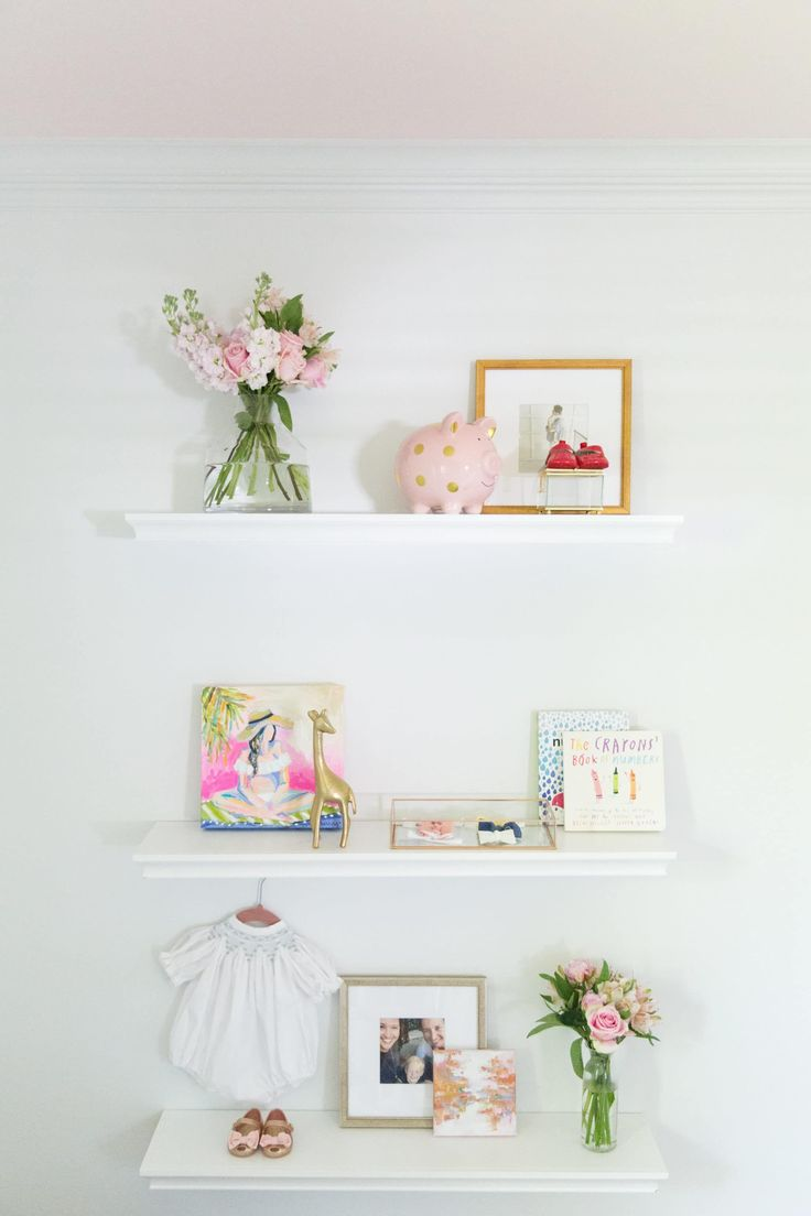 We spy our piggy bank in Olive & Tate's adorable nursery shelf display!