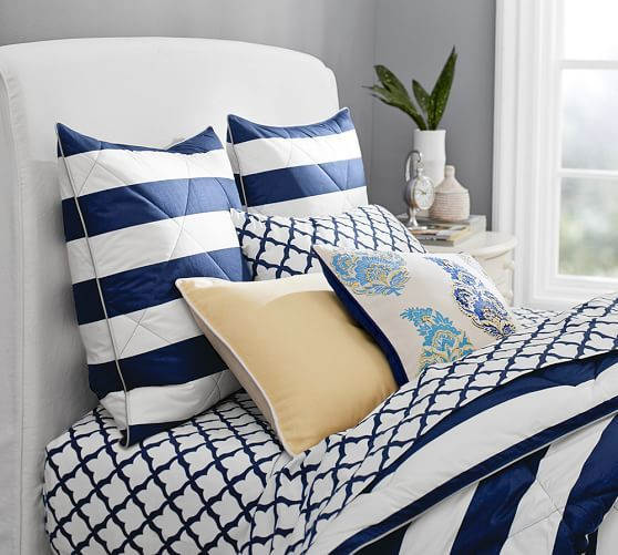 Loving the blue and white bedding! All you need is to add a red pillow and you're set for the Fourth of July Weekend.