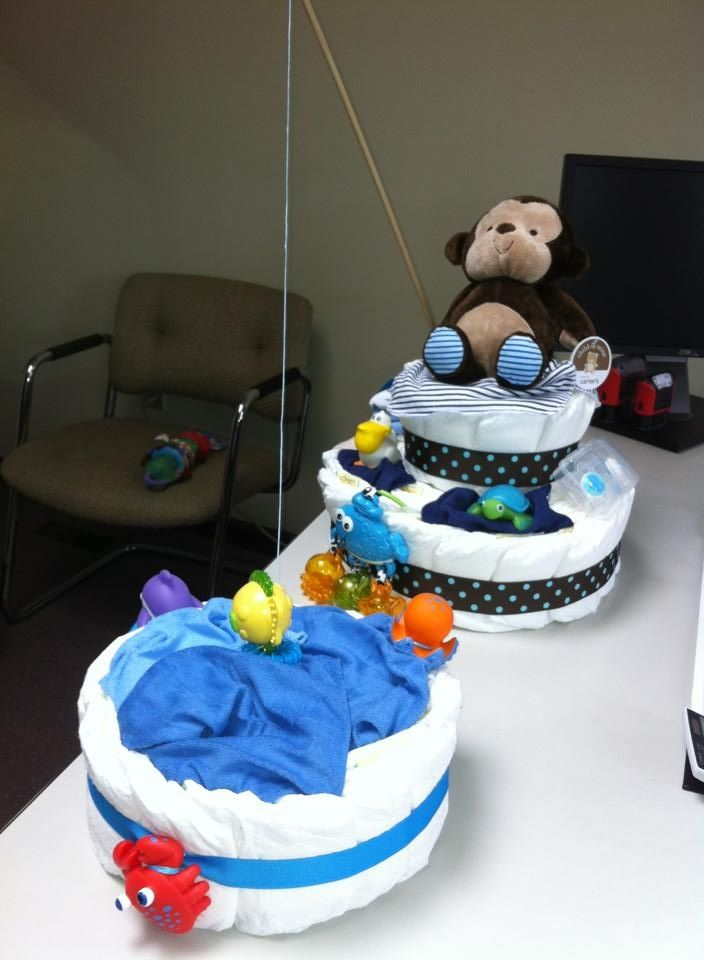 """Fishing theme diaper cake  But instead of a second """"pond cake"""" a bunch of mini """"fish""""cakes (see fish diaper cake pin)"""