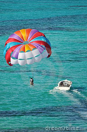 Parasailing over the Caribbean ocean by Lijuan Guo, via Dreamstime