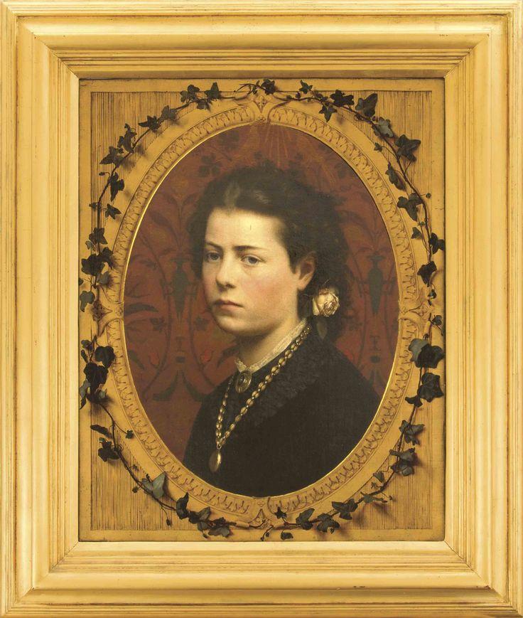 Monogrammist 'HS', möglicherweise russischer Bildnismaler 2. H. 19. Jh., Portrait einer jungen Frau vor einer dunkelroten Tapisserie mit stilisiertem Floraldekor, umrahmt von einem goldfarbenem Trompe-l'oeil-Rahmen von Efeuranken umkränzt, Öl/Lwd., u. re. unaufgelöstes Monogramm 'HS'? (ligiert), sowie dat 1885, Provenienz: aus dem Besitz der Nachfahren des georgischen Herrschergeschlechtes Dadiani, 71 x 55 cm, ger. 95 x 80 cm