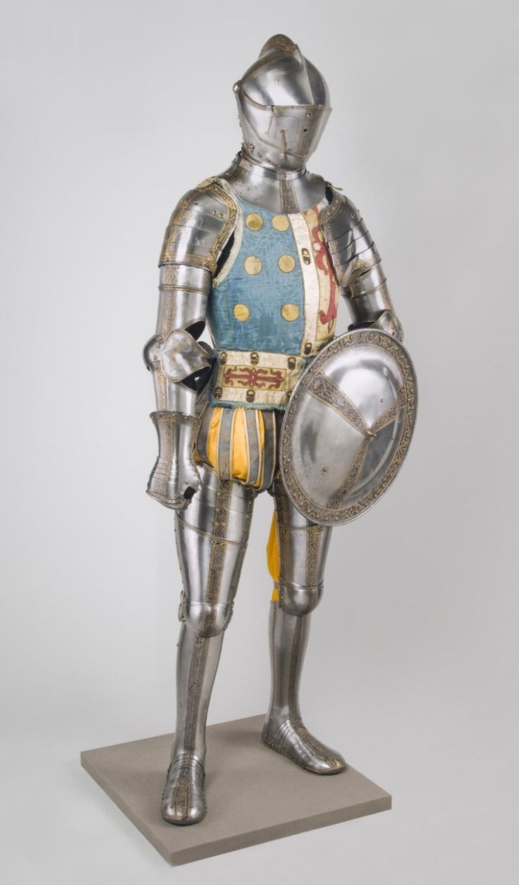 Elements of an Armor Garniture, including Exchange Burgonet (helmet) and Shield, made in Augsburg, Germany circa 1560. Reportedly belonged to the Spanish general, Sancho d'Avila.