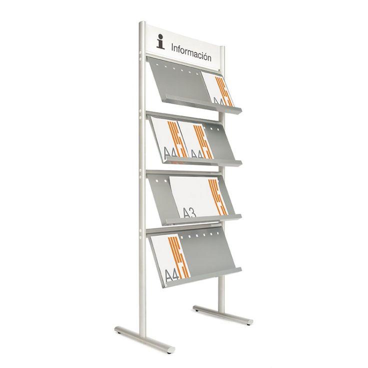 Expositor compuesto por 2 soportes elípticos verticales de aluminio en plata mate, con 4 estantes metálicos pintados en color gris. Ideal para catálogos y revistas en formato A-4. Los estantes existen en 1 o 2 lados. En la parte superior hay un panel gris personalizable. www.mispizarras.es