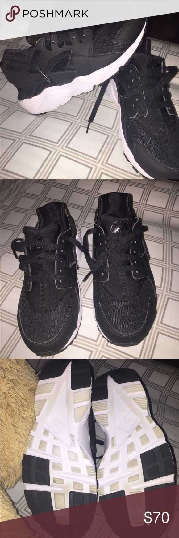 Nike Huarache youth Nike Huarache black and white. Worn once, slight wear on the bottom. Still have the box. They run small and didn't fit me. Nike Shoes Slippers