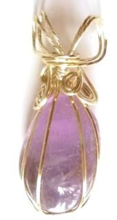 Simple paleish amethyst tumblestone wrapped with champagne coloured copper wire.