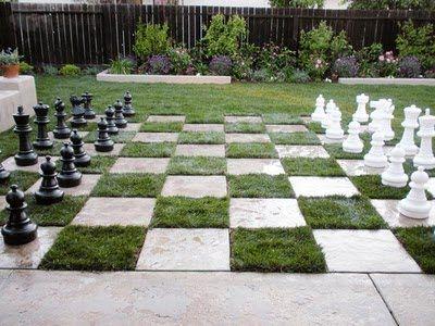 32 square pavers in the grass make a checkerboard.