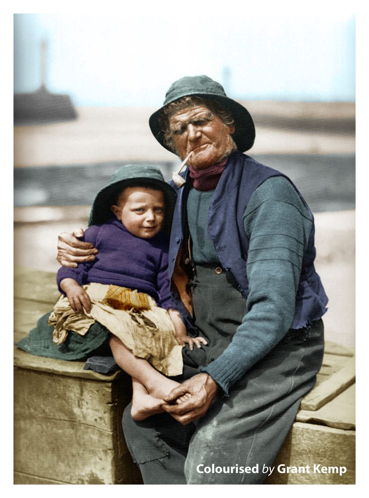 Tom Storr places a protective arm around his great nephew, Robert ''Dandy'' Storr - From the work of Frank Sutcliffe which presented an enduring record of life in the seaside town of Whitby, England