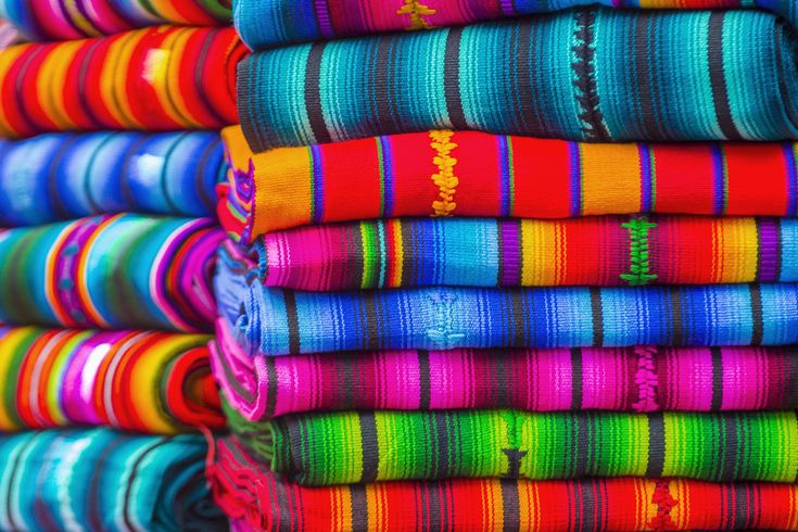 Colourful blankets on the Chichicastenango markets in Guatemala City, one of the many hidden gems of Central America