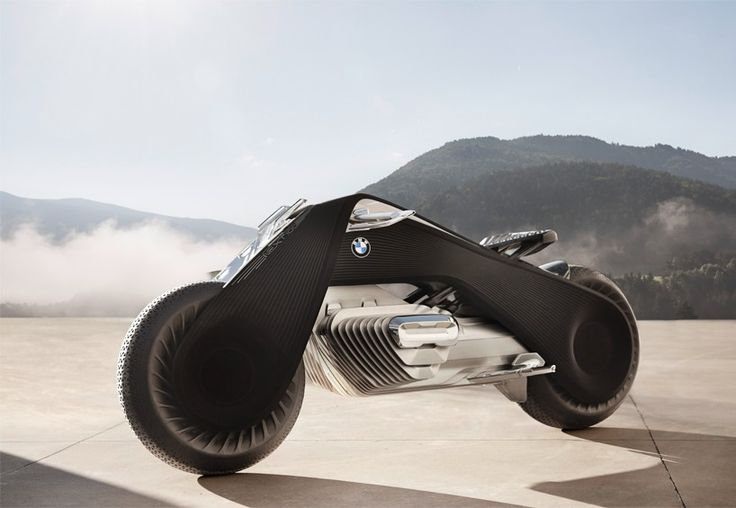 labelled as the 'great escape', the BMW VISION NEXT 100 motorcycle creates a pure and unrestricted rider experience. designboom was at the official unveiling of the concept in LA,