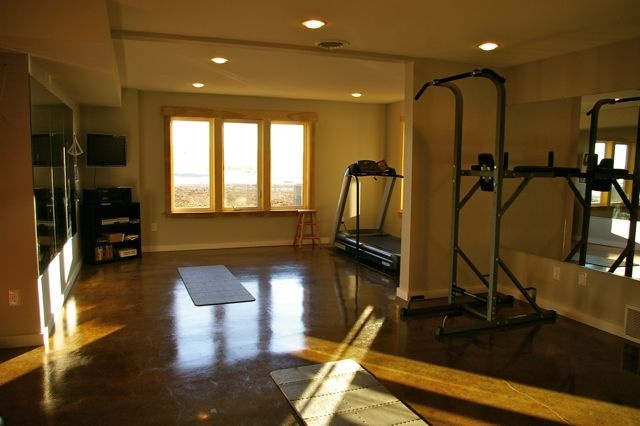 Heated acid stained concrete floors home gym