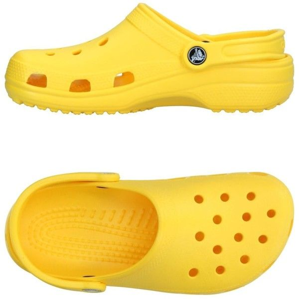 Crocs Sandals ($41) ❤ liked on Polyvore featuring shoes, sandals, yellow, croc footwear, round toe shoes, rubber flat shoes, flat footwear and rubber sole sandals