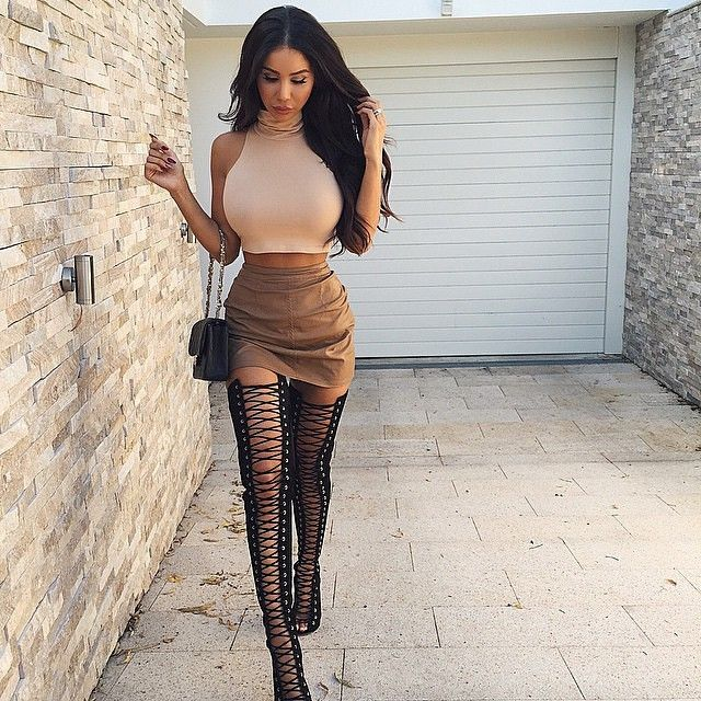 Neutral outfit with laced up thigh high heels