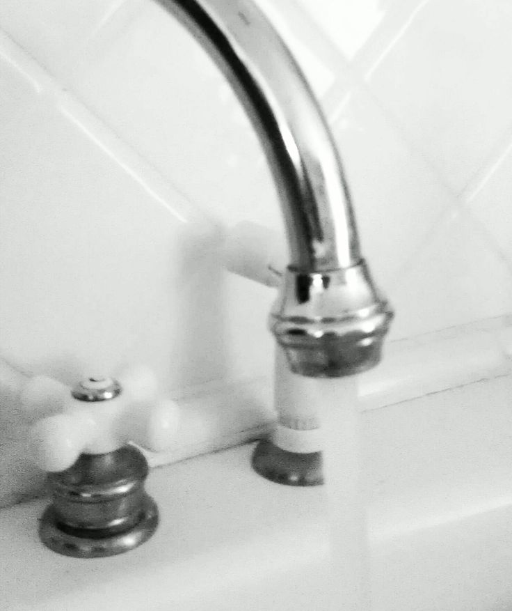 Washing your fruits and veggies under running tap water is the method the FDA recommends.
