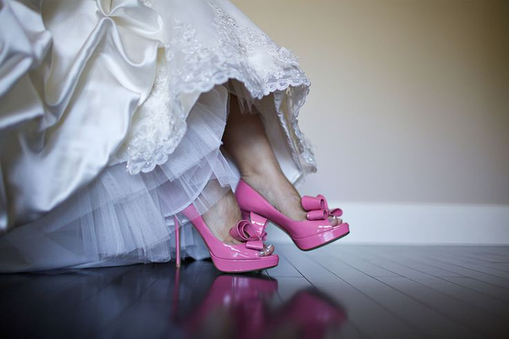 Every bride deserves a fabulous pair of shoes! These pink shoes were perfect for our modern day princess! (Photo courtesy of Andras Schram Photography)
