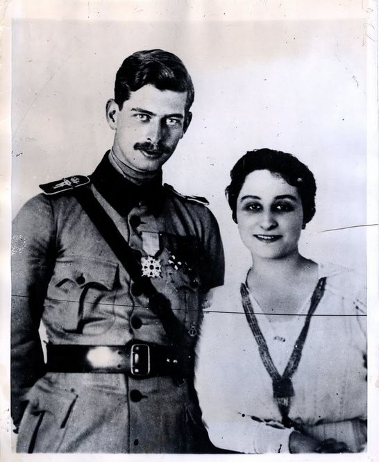 """Crown Prince Carol with his first wife, Joanna """"Zizi"""" Lambrino, a daughter of a Romanian general whom he wed on 31 August 1918 in Russia.  Since she was a commoner and a Romanian the marriage violated Romania's constitution and Carol's father, King Ferdinand, forced an annulment 7 months later.  The couple continued living together, however, and they had a son, Mircea Gregor Carol Lambrino, on 8 Jan. 1920."""