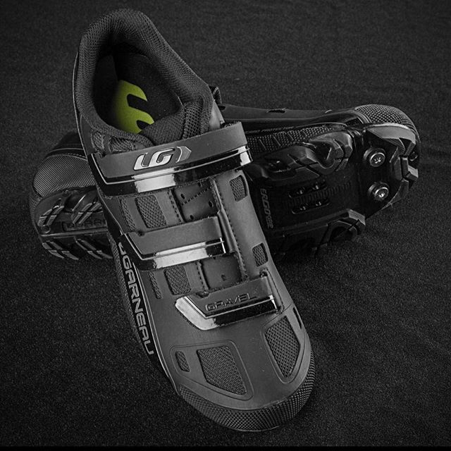 No need to restrict yourself to the paved roads: the Gravel MTB Shoes have everything you need to get out and explore! The Ergo Grip 2 outsole features removable studs – designed to maximize mud clearance and give great grip when you dismount. The shoes are optimized for use with SPD cleat systems. #garneaucycling #GarneauShoes #gravelride #gravelbike #gravelshoes #gravelriding #gravelcycling #cyclingshoes #LiveYourDream #cyclingessentials #blackshoes #Garneau