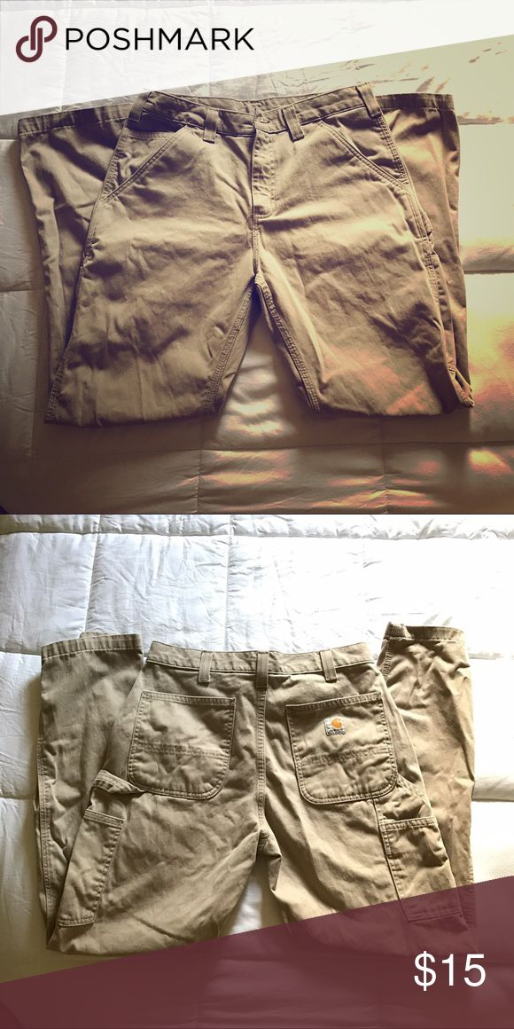 Men's Carhartt Khaki Pants Men's khaki pants, in great condition! Awesome work pants for men and women  because, believe it or not, these are mine! I'm an archaeologist and these were perfect field pants, but I lost some weight and they no longer fit. Now they need a new home! Carhartt Pants Cargo