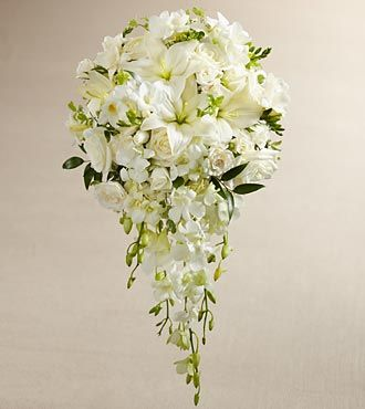 SO lovely!    The FTD® White Wonders™ Bouquet is an exquisite display of wedding elegance. An incredible array of white blooms, including Dendrobium Orchids, roses, Asiatic Lilies, freesia, spray roses, and mini hydrangea are offset by beautiful lush greens and arranged in a cascade fashion to create a memorable bouquet that will complete your bridal look with its sweet sophistication.