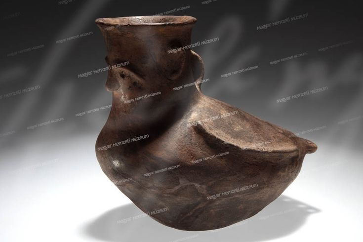 BIRD-SHAPED CLAY VESSEL (ASKOS) WITH A HUMAN FACE  From the mid-2nd millennium BCE (Tiszafüred)