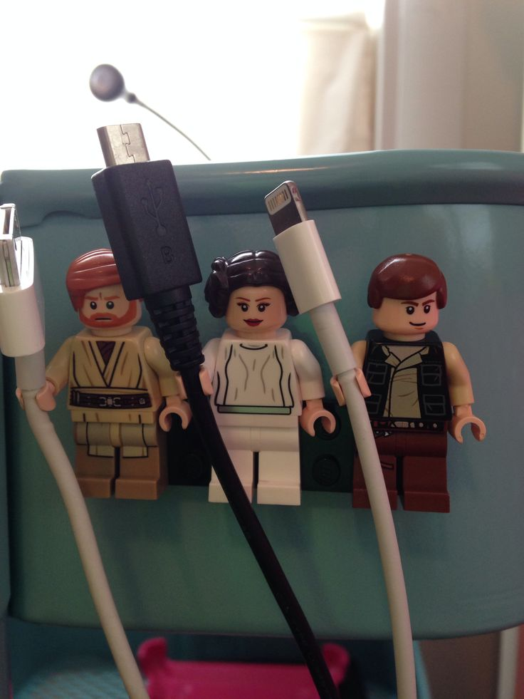 Lego Star Wars cord holder. The brick has a magnetic strip on the back.