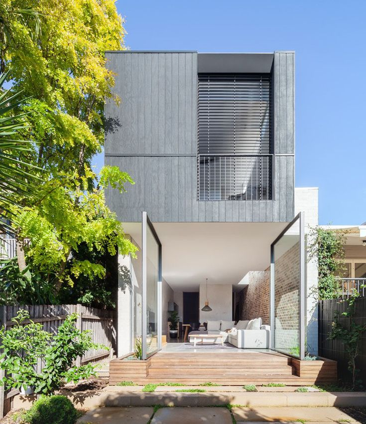 The Back Wall Of This Home Is Made From Two Large Pivoting Glass Doors