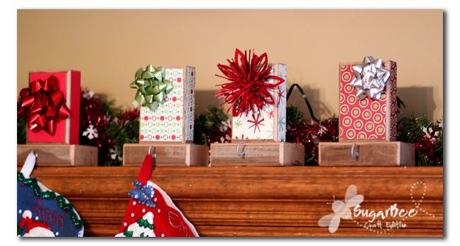 DIY Stocking Hangers: Using 2x4 blocks of wood, make your own adorable stocking hangers for the holidays. Simply wrap the blocks with Christmas wrapping pair and stick on a few bows.