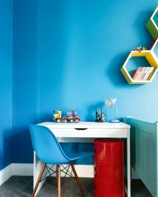 """FINALIST LOWER HUTT, JUDGES COMMENTS: The judges admired this bright, attractive and intensely practical bedroom. """"We love the fact that Debbie's son was so involved in colour selection. The contrasting hexagon display boxes are a masterful detail."""""""