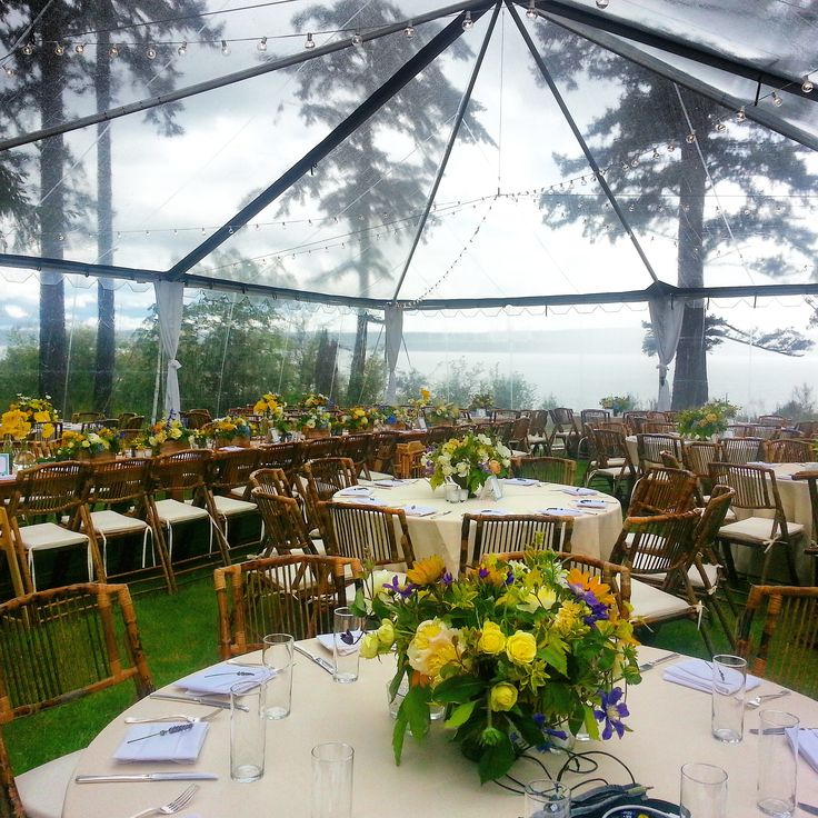 Seattle may have rainy days but dont let that get in the way of your perfect wedding! Try renting a clear tent (instead of the standard white) so you and your guests stay dry but can still enjoy your beautiful venue! We loved this nature inspired decor for this Camano Island Wedding.