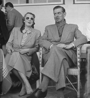 Former King Carol II of Romania and his wife Magda Lupescu, now the Princess Elena of Romania, living more lavishly than any other Estoril exiles in Portugal, 1950