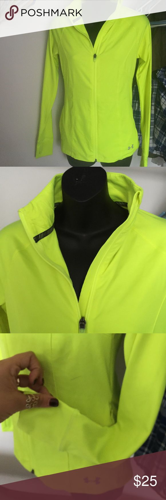 Under Armour workout semi fitted jacket neon top Has a small stain, can we washed off,, full zip and has two thumbholes like lululemon tops and two pockets Under Armour Tops