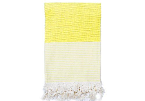 Bring brightness to your bath with a canary yellow Turkish towel.