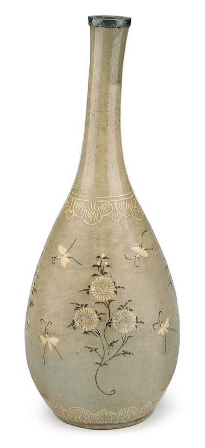 Korean slip-inlaid celadon stoneware vase, koryo period, The slender pear-form vase decorated with butterflies among flowers between lotus petal band to neck and around base, later metal rim. H: 15 inches