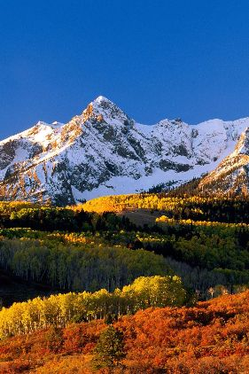 At 236 miles in length, the San Juan Skyway is chock-full of color-morphing aspens, enveloping millions of acres of high mountain passes. (Colorado Scenic and Historic Byway)