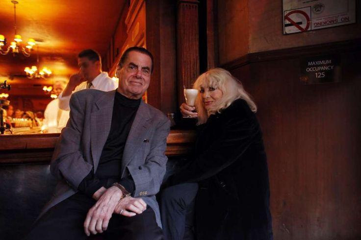 Carol Doda, right, and Dick Winn, pulled up to the bar at Tosca.