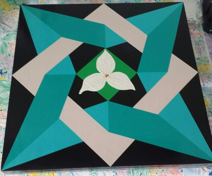 Barn quilt  Laced Star with Trillium Trillium Flowers on barn quilt.