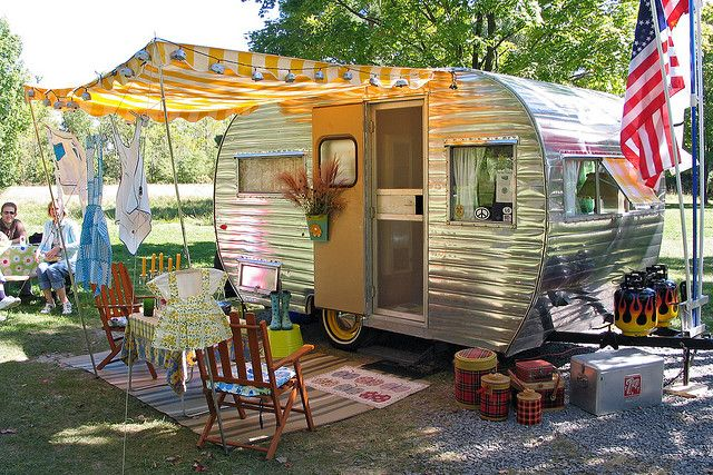 Great idea to redo an old travel trailer as a playhouse for the girls!