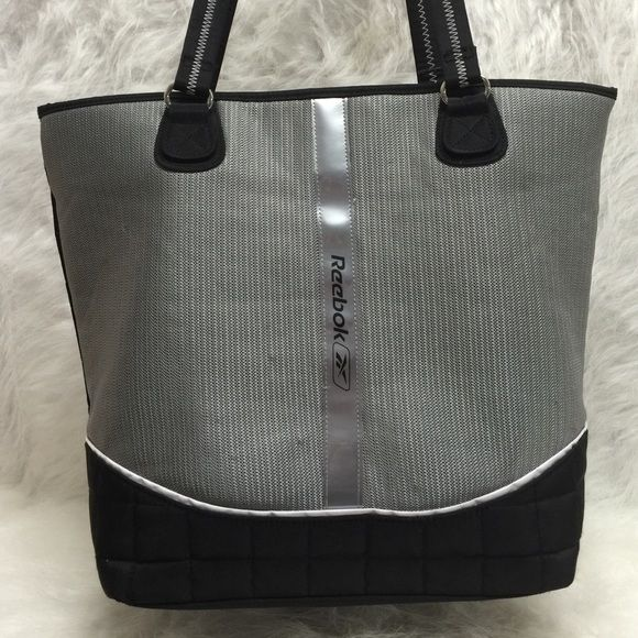 """Reebok Tote Bag Size 17""""w X 13"""" h X 6"""" depth. Pre loved has some gentle used. Three pockets inside. Reebok Bags Totes"""