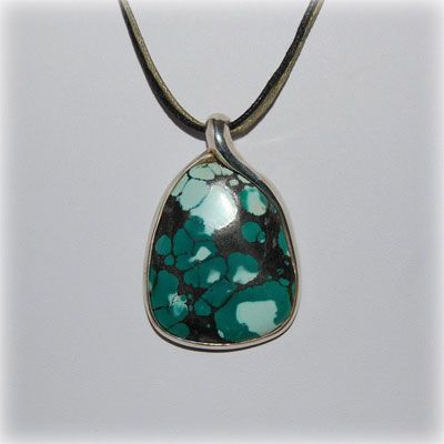 Stunning turquoise pendant with sterling silver setting. Entirely handmade in our workshop.