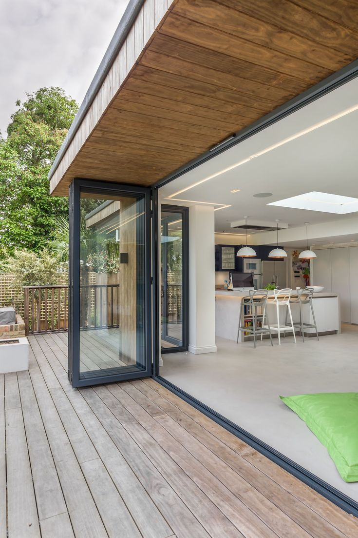 Bi Fold Doors Inside Outside Level Threshold Bifold Doors Level O Flat Roof Design House Exterior House Roof