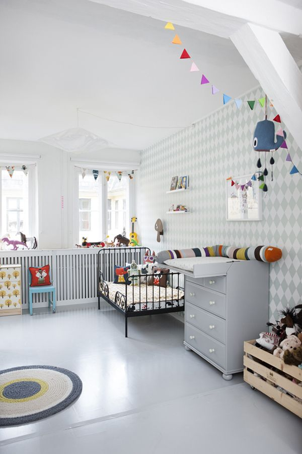 Spacious Chat Room For Kids Clean White Interior Ceramic Floor Patterned Wallpaper Metal Bedframe Wooden Toys Basket