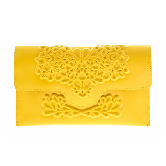 Our yellow slim clutch purse is our latest model and newest addition to our collection of MeDusa clutches. Small and elegant, suitable for evening occasions. Its a sure eye-catcher!  Details: • A Handmade vinyl clutch purse • This clutch is 100% Vegan • Contains inner pocket with a zipper • Closes with a magnet closing  Materials: Embossed PVC and leather like black fabric Dimensions: • Width: 9.5 inch (24 cm) • Height: 6 inch (15 cm) • Depth: 0.8 inch (2 cm)  Care instructions: One wipe…