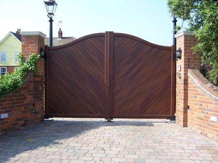 Aluminium gates can now look like real wood but they last much longer and don't really need looking after.