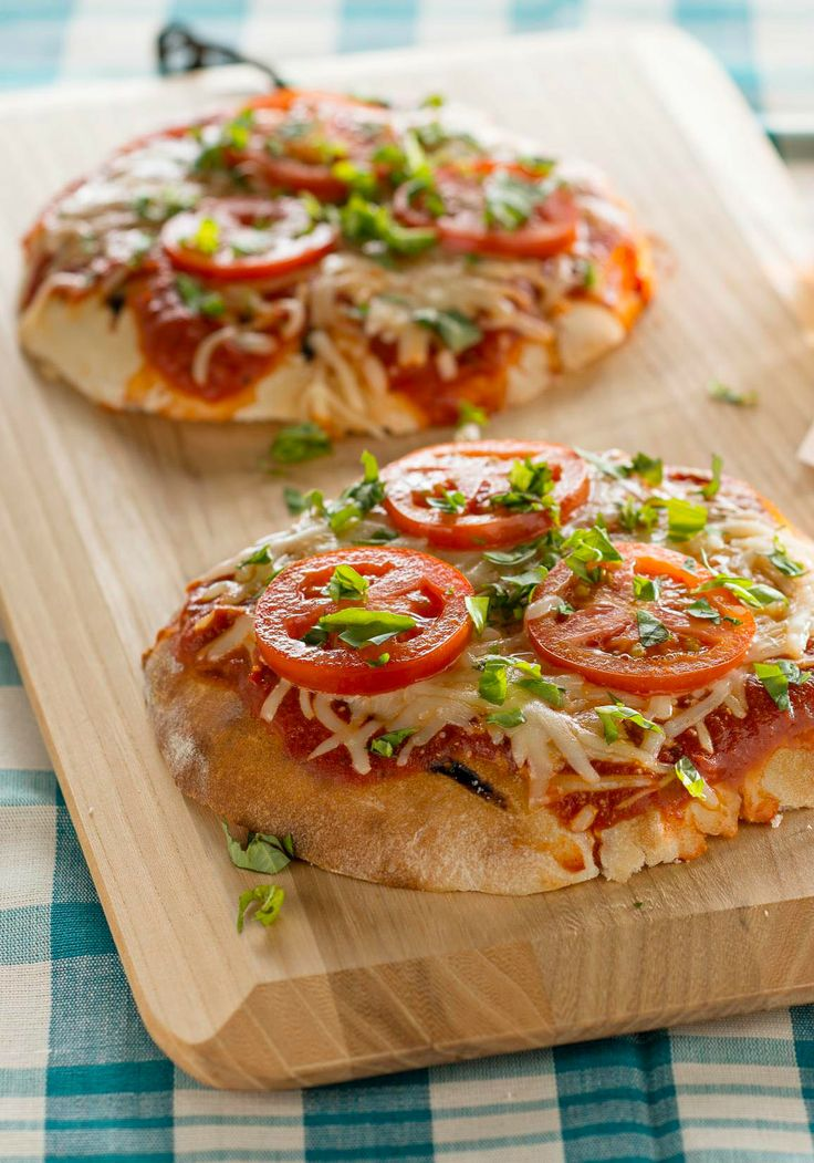 Grilled Tomato-Basil Pita Pizzas — Making pizza for two is easy when your crust is a pita bread and the topping is a simple blend of plum tomatoes, basil, pizza sauce and cheese.