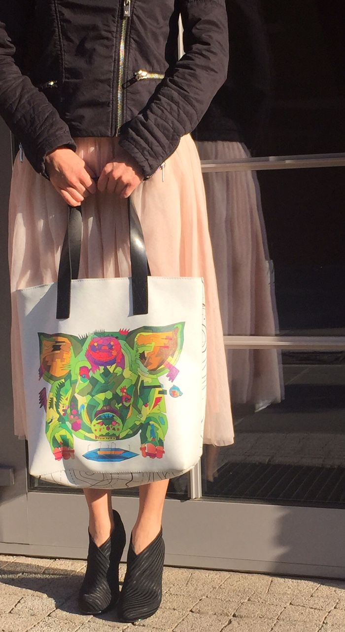 shopping bag with the feeder graphic print  by kulik. tote bag with leather handles.