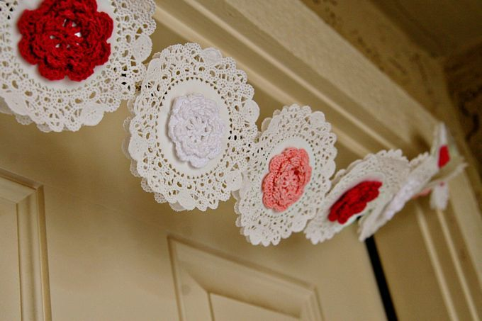 A fun way to use crocheted flowers: a bunting with crocheted flowers & doilies (lovely pictures and tutorial for the bunting; no pattern for the flowers)