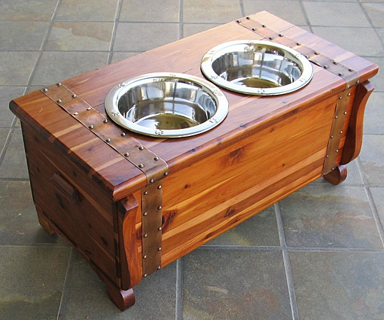 Miniature Cedar Chest Pet Feeder - repurposed miniature cedar chest dog feeding station. Elevate your dog's food and water source to minimize joint stress and keep their food and water off the floor in style. This vintage charmer  has been converted to a retro dog feeder with storage, too.   Fantastic original, solid cedar wood chest has brass strapping and carved trim.