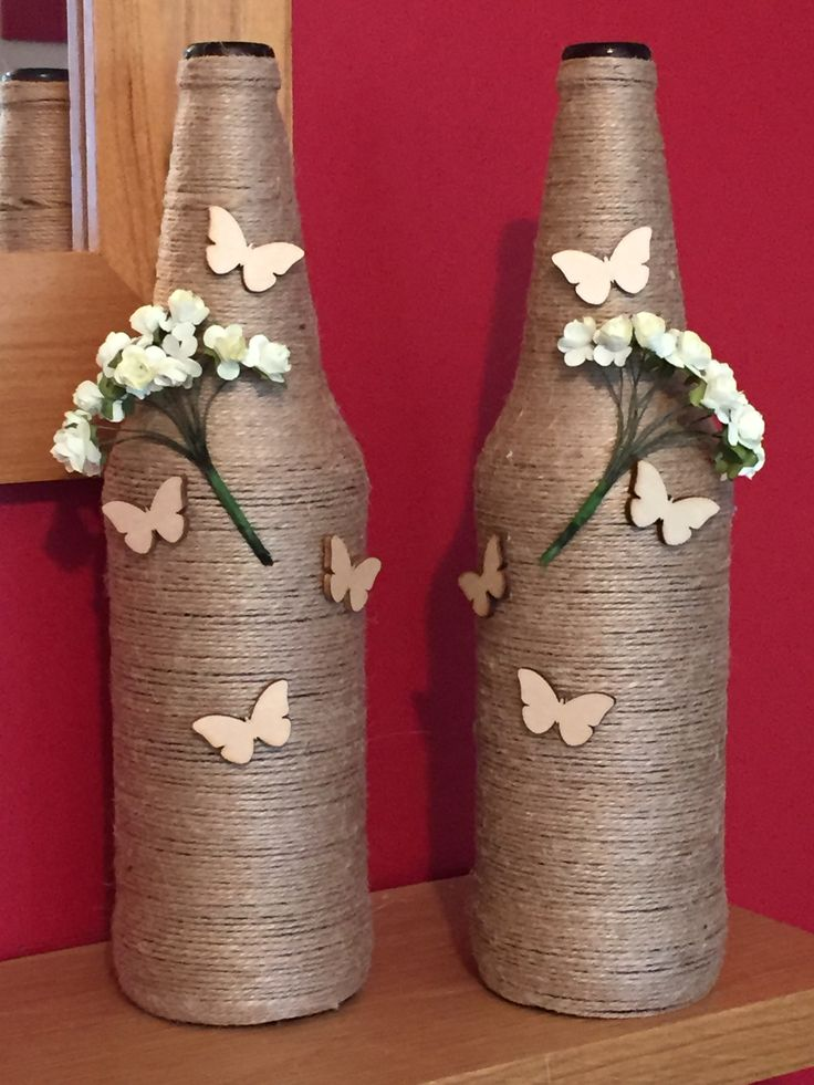 Love these so easy to make .. Brown Beer bottles, PVA glue the string around the bottle, starting from the top down as it doesn't work from the bottom up as I found out.. Then once dry after a few hours hot glue flowers and butterflies to the bottle .. Fab new edition to my crafts..